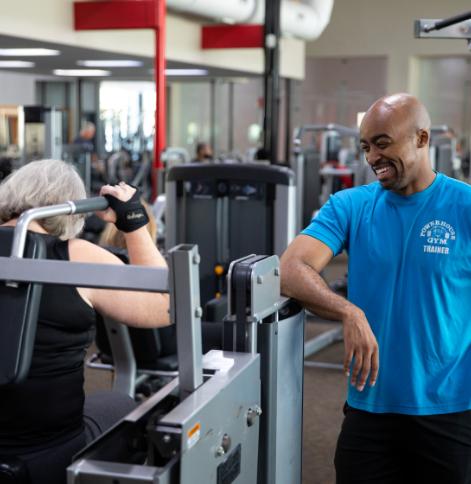 Man training woman in gym